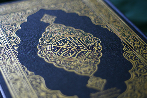 The Qur'an is a record of the exact words revealed by Almighty Allah through the Angel Gabriel to the Prophet Muhammad. It was memorized by Muhammad and then dictated to his Companions, and written down by scribes, who cross-checked it during his lifetime.