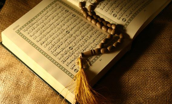 How does God address the People of the Book in the Qur'an, and why does He warn them against extremism?